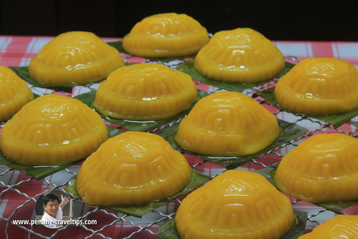 Soft, golden-colour Pumpkin Ang Koo fresh from the steamer