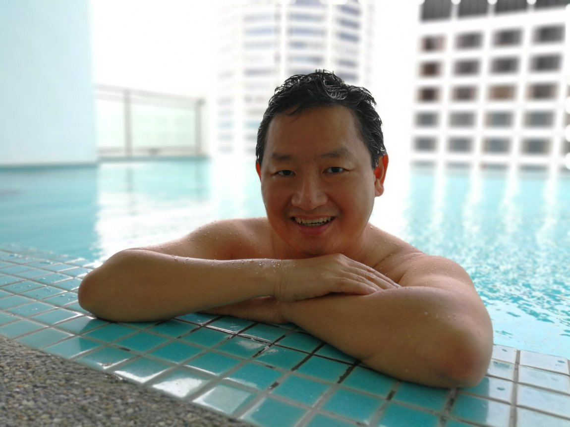 Enjoying the swimming pool of The Wembley Penang