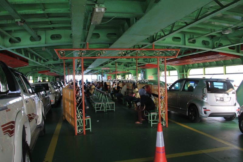 Cars and passengers sharing deck space