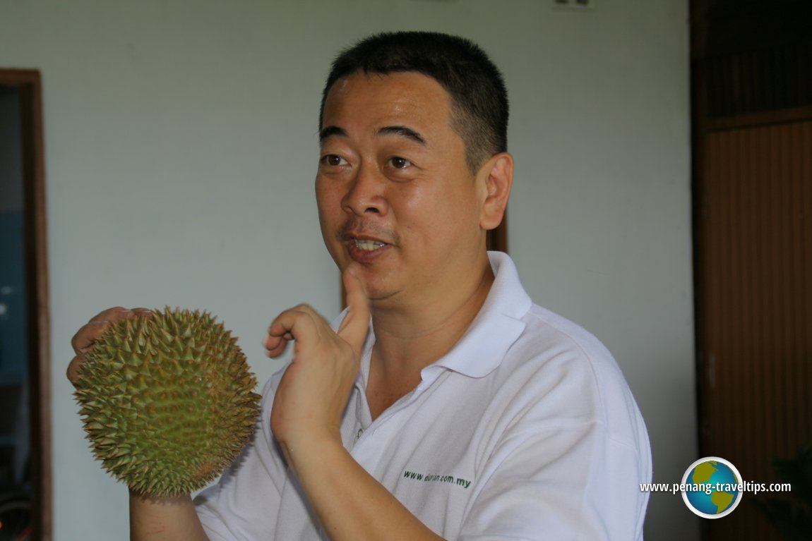 Durian Seng explaining how durian is appraised