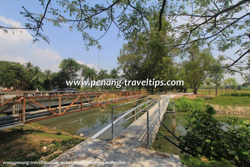 Pedestrian bridge across Sungai Gelugor at The Light Waterfront Linear Park