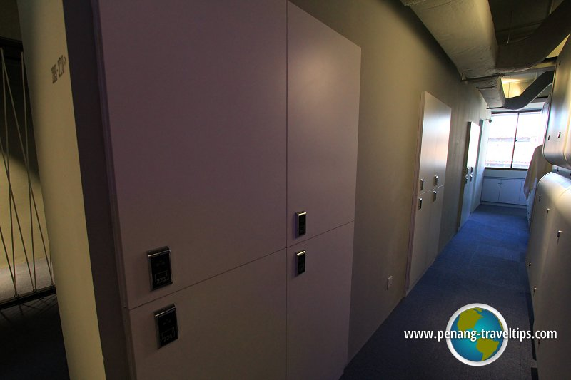 The luggage storage compartments at Time Capsule Hotel