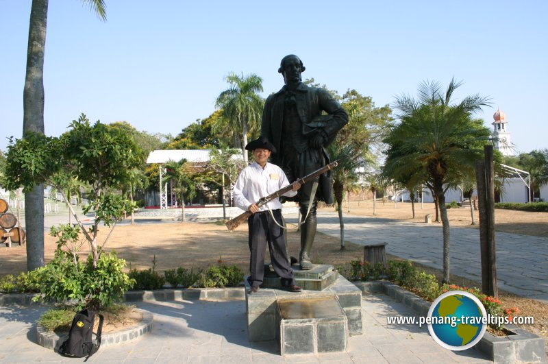 Timothy Tye with Francis Light's statue