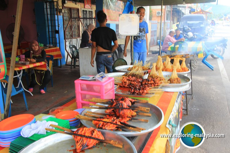 Barbecued chicken and satay on sale by the roadside in Semeling