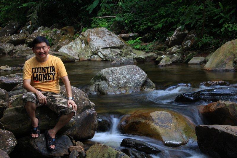 Relaxing beside the cascades of Titi Hayun Recreational Forest in Kedah