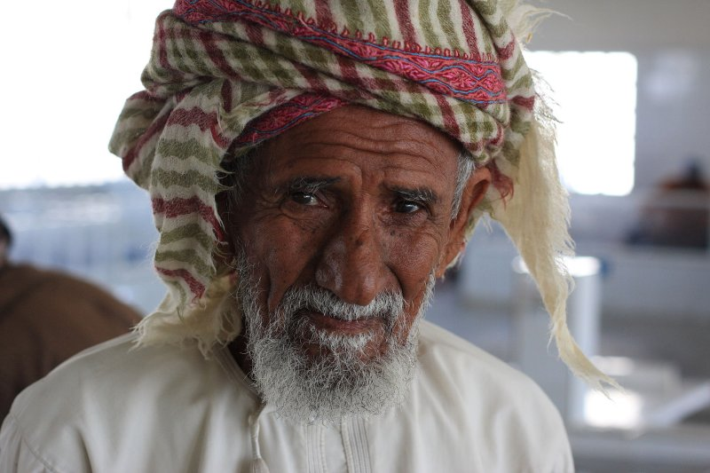 An elderly gentleman at the fish souk in Muscat