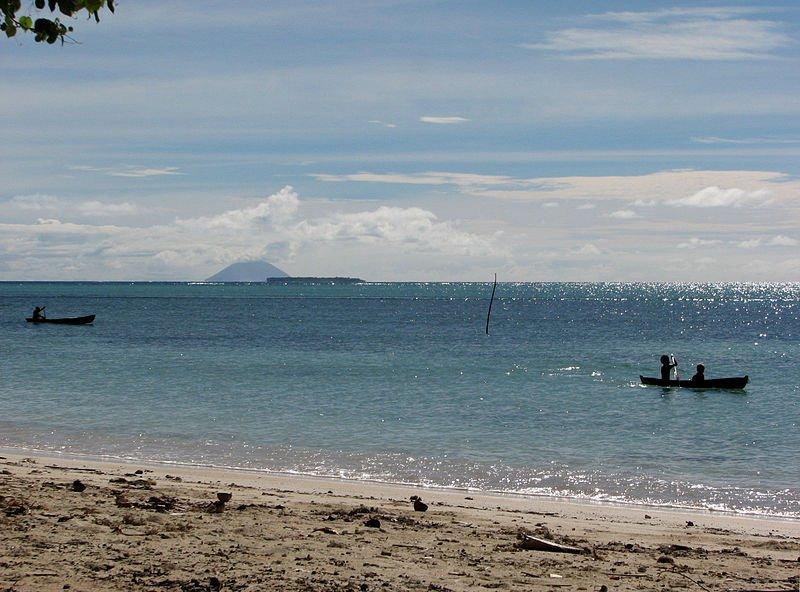 Fenualoa, Solomon Islands, with the active volcano Tinakula in the background