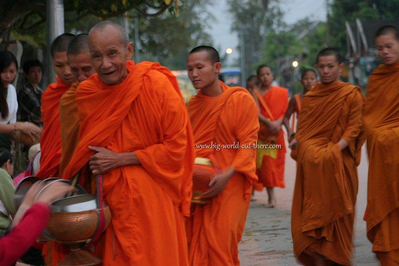 Laotian monks receiving alms