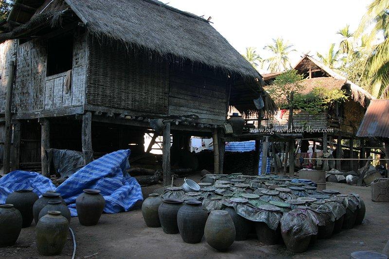 Brewing Lao whisky, in a village near Luang Prabang, Laos