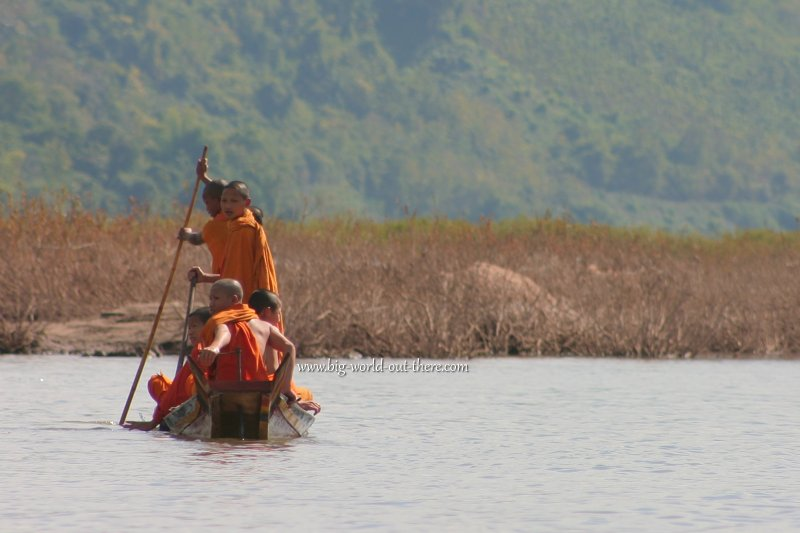 Novice monks crossing the Mekong in Laos