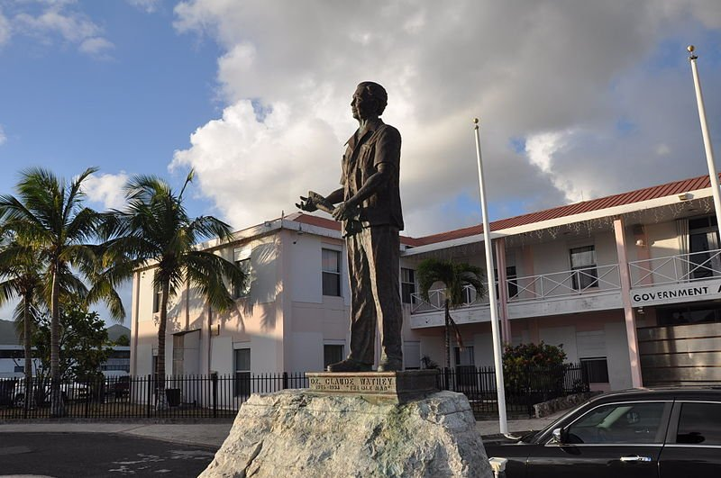 Statue of Dr Claude Wathey in front of a government building in Philipsburg