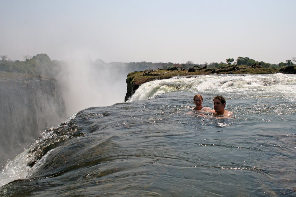 Tourists swimming is a safe pool at Victoria Falls, Zambia