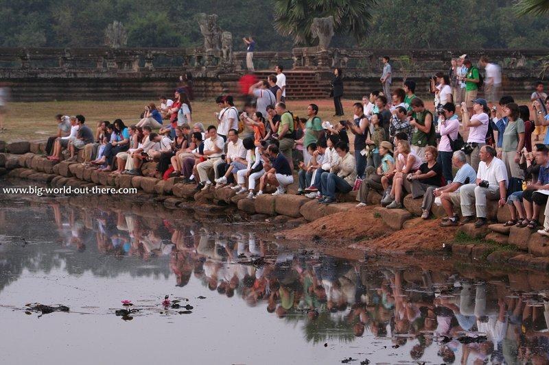 Tourists watching sunrise at Angkor Wat