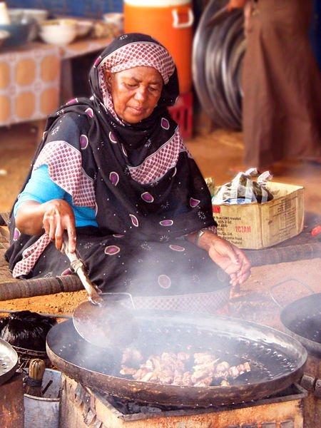 Woman preparing food, Sudan