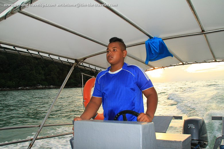 My boatman at the Penang National Park was a boy with a mohawk hair cut