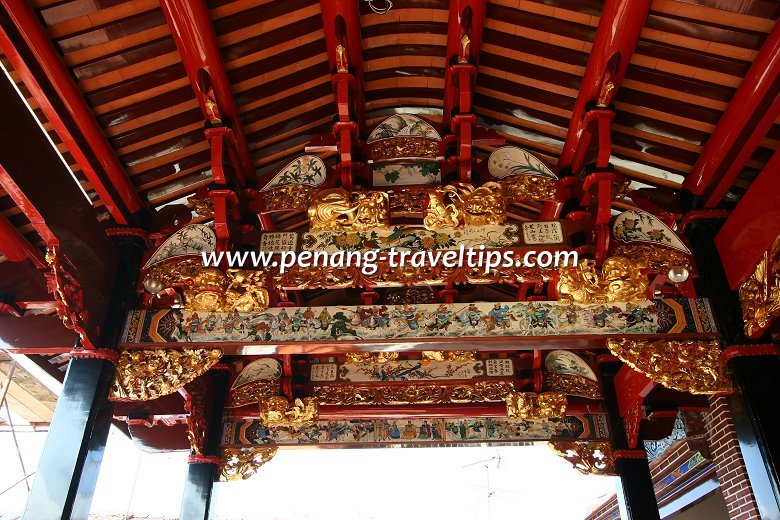 Intricate artwork on the ceiling beams reflect the artistry of the Chinese craftsmen