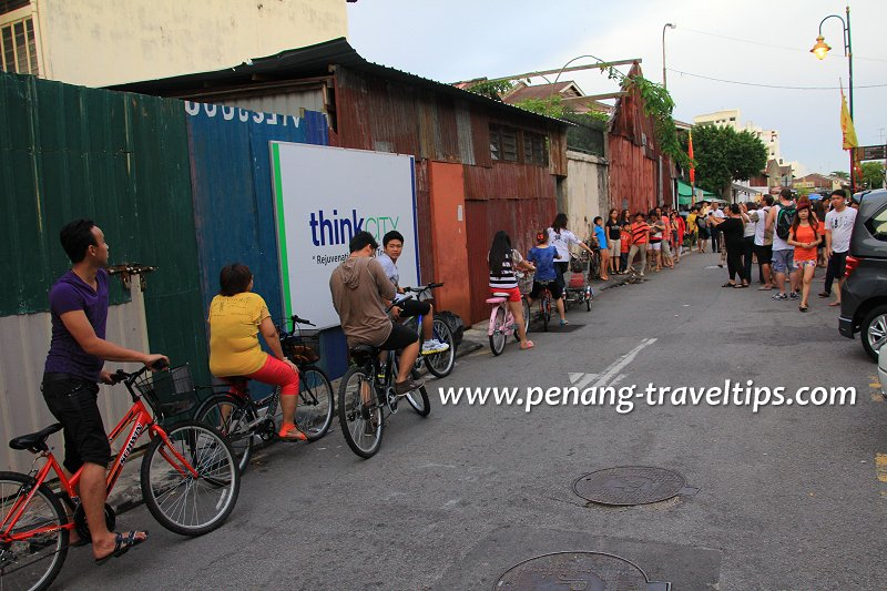 Queue at Little Children on a Bicycle mural